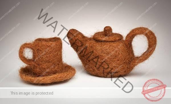 """Annin Barrett (American) """"Hair Teapot and Cup"""" 2011 human hair and thread. Teapot 4.5 x 8.5 x 4.5"""". Teacup and saucer 3.5 x 5 x 5"""". Photos: Annin Barrett 2011.7"""