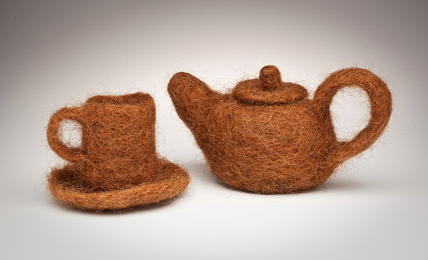 "Annin Barrett (American) ""Hair Teapot and Cup"" 2011 human hair and thread. Teapot 4.5 x 8.5 x 4.5"". Teacup and saucer 3.5 x 5 x 5"". Photos: Annin Barrett 2011.7"