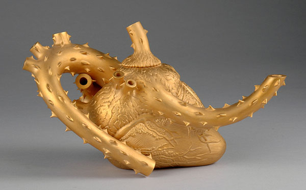 "Richard Notkin ""Sharpesville Krugerrand"" 1990 stoneware, gold luster 6.125 x 10.75 x 5.25"". Photo: Kevin O'Dwyer. 2004.6.2"