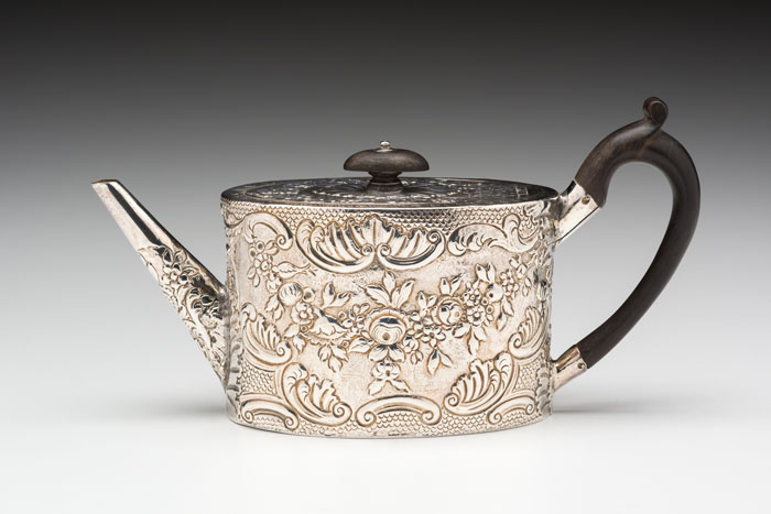 Sterling silver teapot by Hester Bateman (British, c. 1709-1794). Teapot, 1782. Sterling silver and ebonized wood, 3.75 x 10 x 3.13″. Kamm Collection 2000.118. Photo: David H. Ramsey.