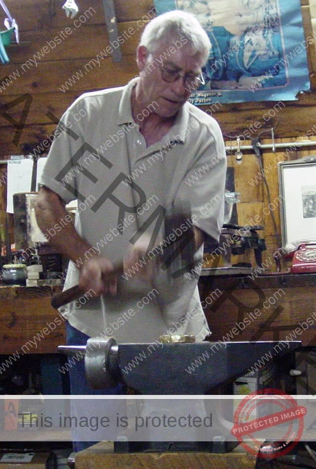 Gary Noffke hammering.