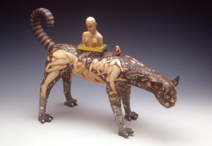 "Sergei Isupov, ""The Cat Walks Alone For Herself"" 1997. Porcelain, ceramic stain, glaze, 14 x 15 x 8.5 in. Kamm Collection 1997.113. Photo: Tony Cunha."